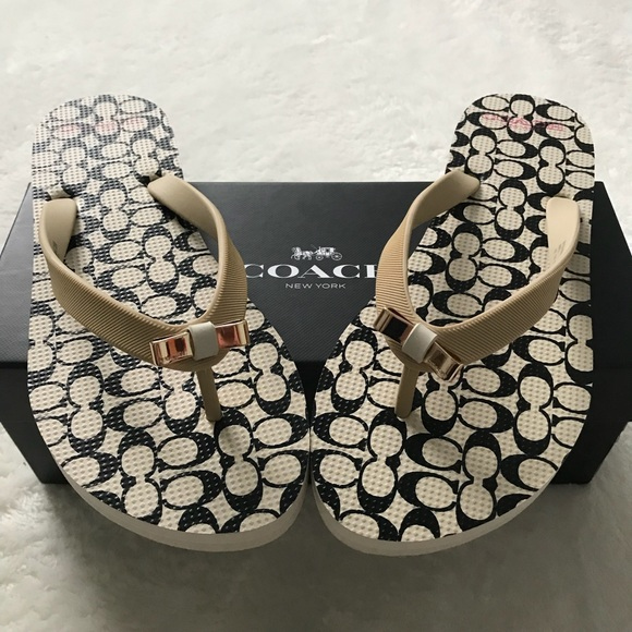 16d3ae758e18 NWT Coach Amel rubber flip flops in milk and black